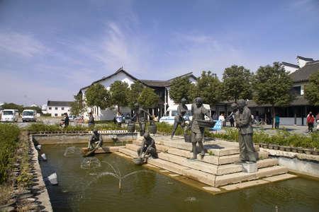 Statue and spring in a scene of beautiful Wuzhen town in Jiaxing ,Zhejiang, China  Stock Photo - 13670055