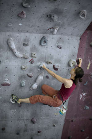 climbing sport: A girl doing her bouldering training