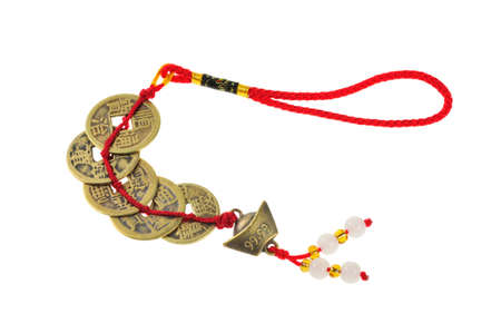 charms: Ancient Chinese coins connected by red strings and knots and decorated with small jades  Stock Photo