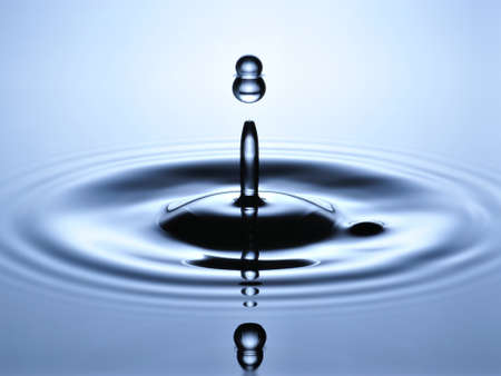 collide: A small water drop fall on water surface and jump back to collide with the second one, forming a calabash shape splash  Stock Photo