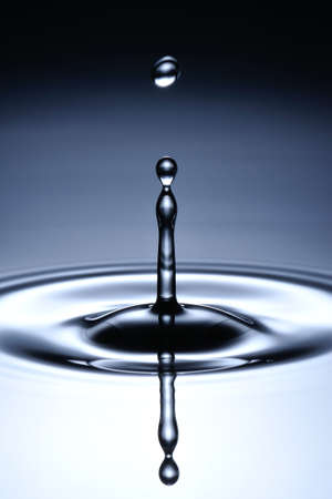 collide: A small water drop fall on water surface and jump back before the second one to collide with it
