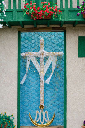 hollidays: In the Canary Islands (Spain), on 3 May,  they celebrate the day of the cross. That day, the neighbors decorate the crosses with fabrics, flowers and jewels to be the prettiest cross of the island.