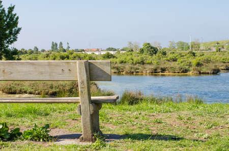 marshes: Beautiful bench to sit and relax in the marshes of Santona, Cantabria, Spain. Stock Photo