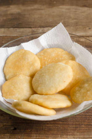 pone: Tray of freshly fried arepas, typical Latin American food made with cornmeal.