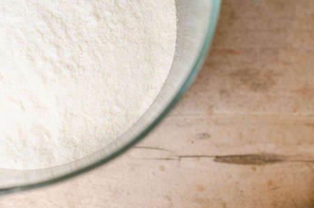 pone: Corn flour on a wooden table.