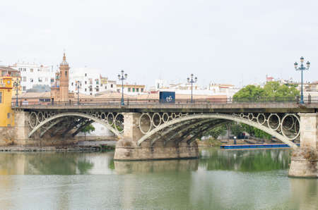 isabel: The bridge of Isabel II, popularly known as Triana Bridge, is a bridge located in Seville (Andalusia, Spain), which links the city center with the Triana district across the river Guadalquivir