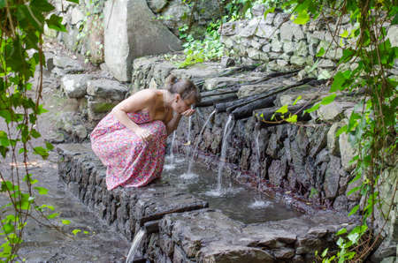 vallehermoso: Tourist drinking water of Chorros de Epina, La Gomera, Canary Islands, Spain.