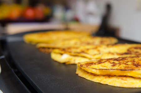 Grilled cachapas, typical venezuelan food (cornmeal tortilla). Stock Photo - 56005955