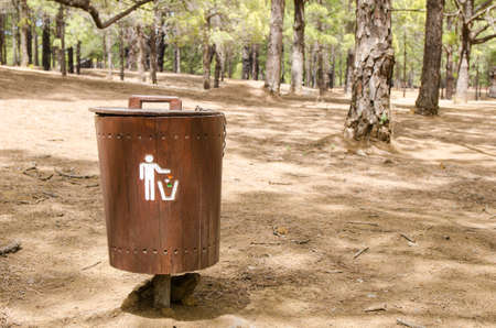 public waste: Wooden litter bin in the forest.  Concept of clean nature and ecology.