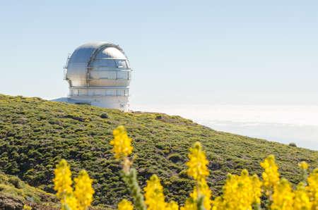Grantecan (Gran telescopio de Canarias) in Roque de los Muchachos Observatory in La Palma, Canary Islands, in spring with blue sky.