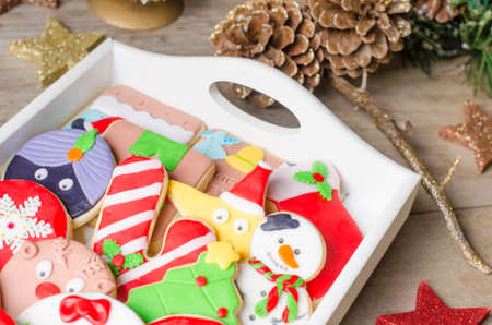 many christmas baubles: Tray full of colorful Christmas cookies decorated with fondant. Stock Photo