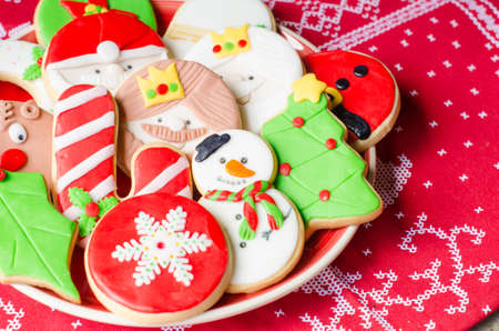 Plate full of colorful Christmas cookies decorated with fondant.