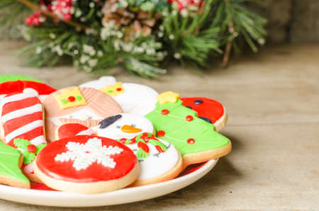many christmas baubles: Plate full of colorful Christmas cookies decorated with fondant.