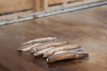 Grilled razor clams on the grill, typical food of Galicia, Spain Foto de archivo