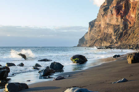 Playa del ingles beach, black sand beach at the atlantic ocean in La Gomera, one of the canary islands, Spain