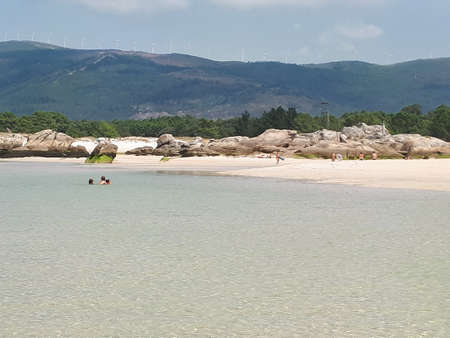 Natural pool of the beach boca do rio, Carnota, Galicia. They form at low tide at the mouth of the Vadebois river on said beach. Stock Photo