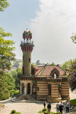 Comillas (Cantabria, Spain) - Caprice of Gaudi, 23 May 2018. El Capricho is a mansion designed Antoni Gaudí and it´s considered as one of the jewels of European modernism. Tourists visiting the palace Stock Photo - 104912786
