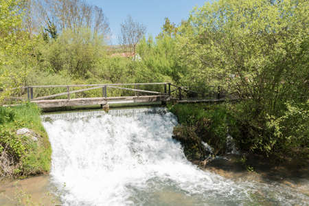 Small waterfall near the source of the Ebro river in Fontibre, Cantabrial, Spain Stock Photo