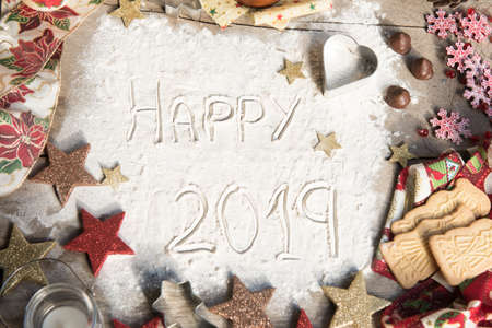 Happy 2019 text made with flour. Stock Photo - 106107312