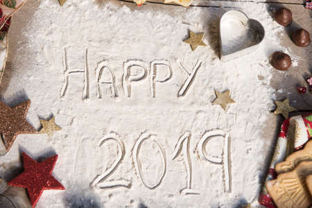 Happy 2019 text made with flour. Stock Photo - 106107316