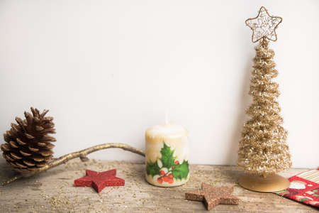 Christmas decoration on white and wooden background.