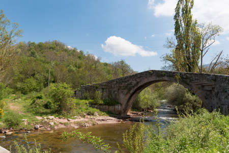 Roman bridge crossing the Hijar river in Entrambasaguas, Cantabria, Spain