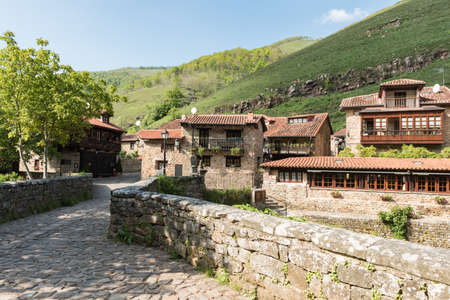 Barcena Mayor, Cabuerniga valley, with typical stone houses is one of the most beautiful rural village in Cantabria, Spain. Stock Photo