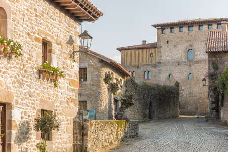 Street with typical architecture in Santillana del Mar, a famous historic town in Cantabria, Spain.