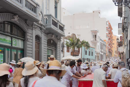 SANTA CRUZ DE LA PALMA, CANARY ISLANDS, SPAIN - MARCH 04, 2019:  People enjoying in Los Indianos Party during the carnival in Santa Cruz de La Palma. In this party people wear white clothes and have fun dancing Cuban music and lacing talcum powder. Editorial