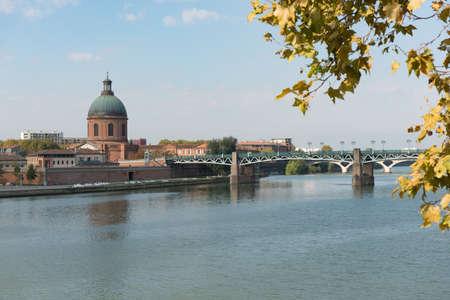 The Saint Pierre bridge passes over the Garonne river and Hospital de La Grave in Toulouse, the French pink city.