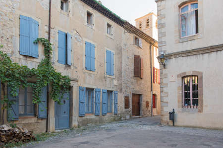 The medieval stone architecture and the old narrow street of Lagrasse, the most beautiful medieval village of France. Stock Photo