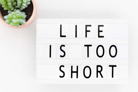 Inspirational Typographic Quote - Life is too short, text on lightbox