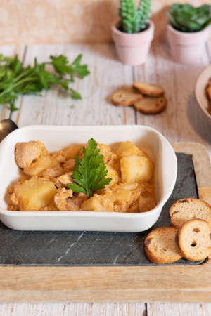 tuna and potato stew called marmitako. Traditional Basque recipe with tuna, potatoes and onion. Spanish food