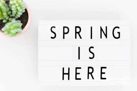 Text spring is here in lightbox,  with white background
