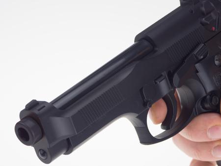 Hand with black gun Stok Fotoğraf