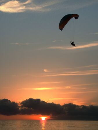 paragliding on the see at the sunset Stock Photo