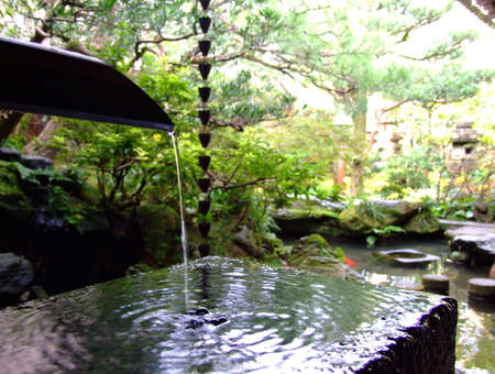 Stock Photo   Water Basin In Japanese Style Garden And Chain