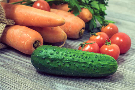 Concept of healthy nutrition and vegetarianism. Close up photo of different tasty fresh juicy vegetables on wooden table Stock Photo