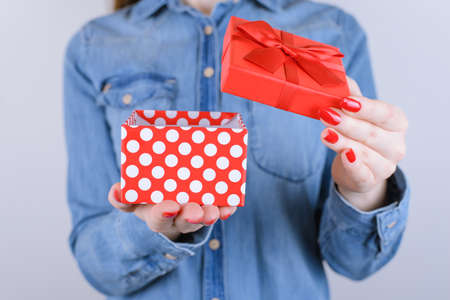 Desire romantic fun joy camera you cap xmas christmas new year valentine anniversary friend family little you person people teen age concept. Cropped close up photo of gift isolated on gray background Banque d'images