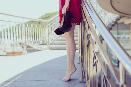 Elegant graceful glamour relax balcony railings urban getaway vogue design girlish feminine pedicure concept. Side half profile close up view photo of stylish exhausted lady standing on toes 免版税图像