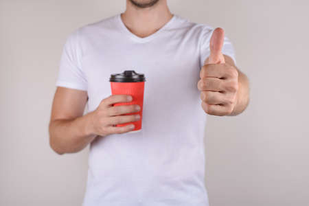Ok satisfied good nice great advertising ad nice mocha concept. Cropped close up photo of happy glad guy making giving finger up to camera isolated grey gray background copy space
