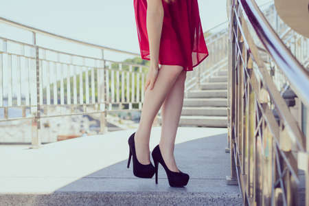 Close up low angle view photo portrait of pretty nice elegant lady holding leg massaging the place Stok Fotoğraf