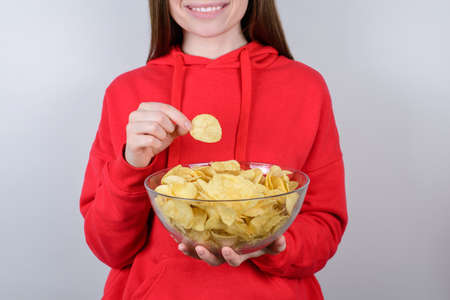 Cinema rest relax chill free time break leisure concept. Cropped closeup photo of cheerful excited glad nice person teen holding big bowl in hands isolated gray background