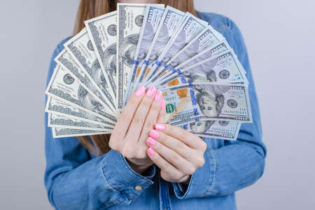 Close-up cropped view photo of pretty wearing casual outfit she her lady holding big pile of money in hands isolated grey background