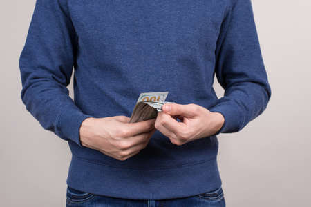 Easy money freelance concept. Cropped closeup photo of confident satisfied investor having great idea for new project check cashback isolated grey background