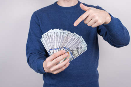 Cropped close-up studio photo of confident luck lucky student demonstrating lot of money getting salary for part time job isolated grey background