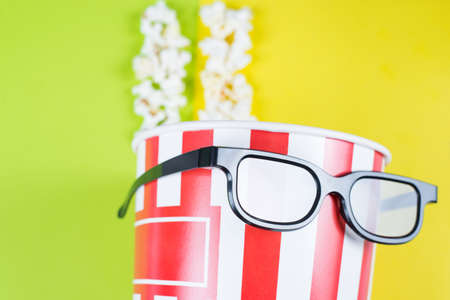 Closeup cropped view photo of paper box with tasty popcorn wearing black cool with reflection specs behaving like a human enjoying premiere isolated colorful background