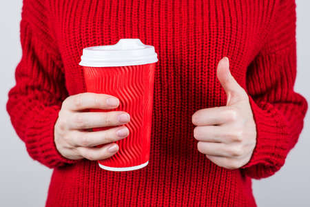 Cropped close-up photo of cheerful positive glad person recommending you nice coffee raising finger up isolated grey color background