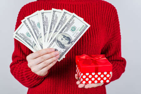 Cropped closeup photo of lucky successful leader people having good present in financier hands and small with bow box isolated grey background Фото со стока