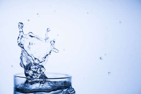 Ecology clean water concept. Cropped close up image picture photo of drinkable water with beautiful splash isolated over light blue white background Reklamní fotografie